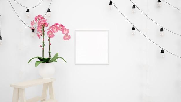 白い壁と美しい装飾的なピンクの花に掛かっているランプと空白のフォトフレームモックアップ 無料 Psd