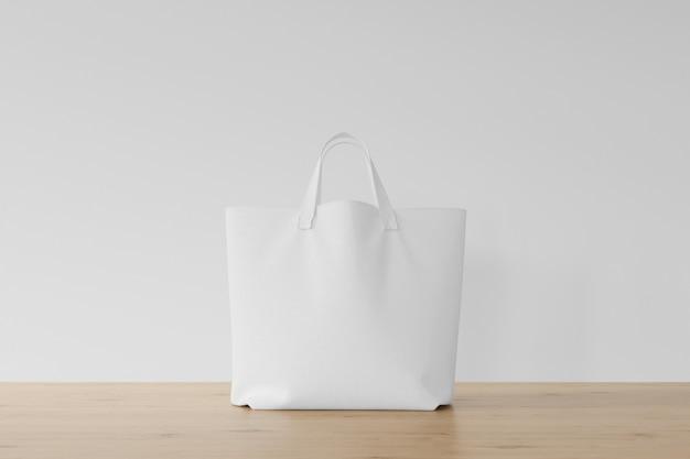 Белая сумка на деревянном полу Бесплатные Psd