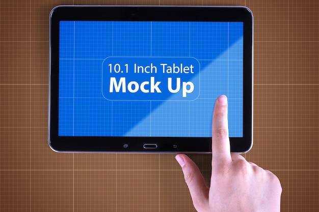 タブレットと手のモックアップ Premium Psd