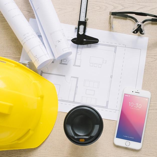 紙とスマートフォンモックアップによる建築構成 無料 Psd