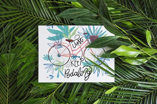 熱帯の葉の中の紙モックアップ 無料 Psd