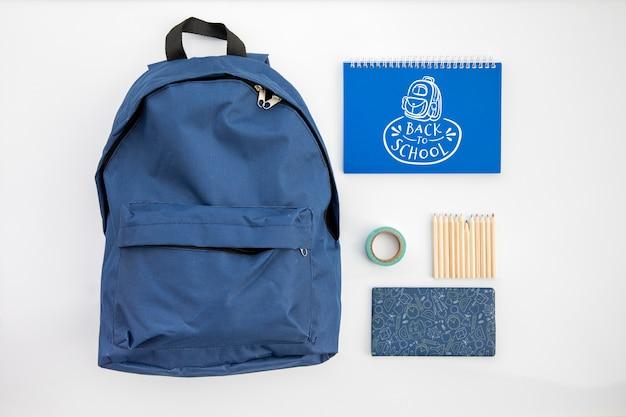 Снова в школу, рюкзак со школьными принадлежностями Бесплатные Psd