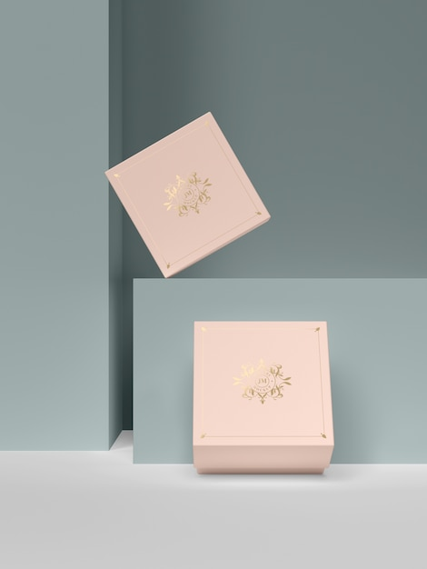 Две розовые шкатулки с золотыми символами Бесплатные Psd