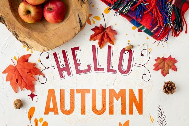 こんにちは、乾燥した葉とリンゴの秋のコンセプト 無料 Psd