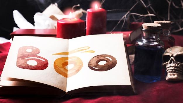 Хэллоуин украшение стола и книга с бу! текст Бесплатные Psd