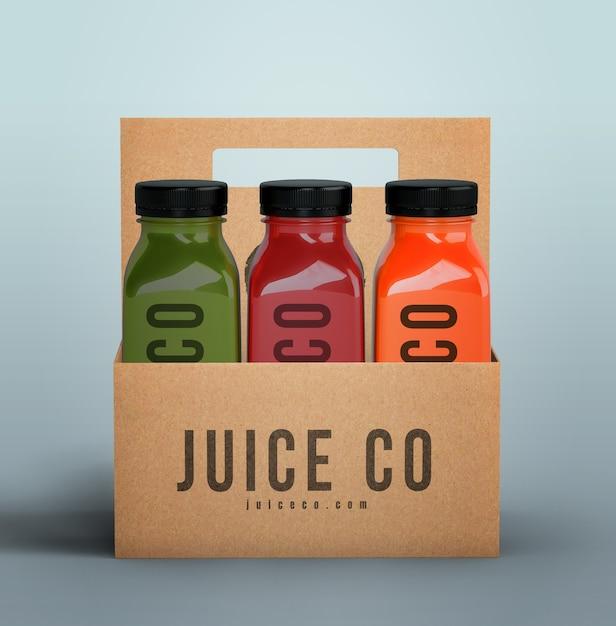 Пластиковые бутылки органического смузи в картонных коробках вид спереди Бесплатные Psd