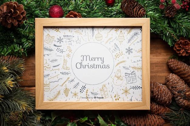 Рождественский сосновый декор с рамочным макетом Бесплатные Psd
