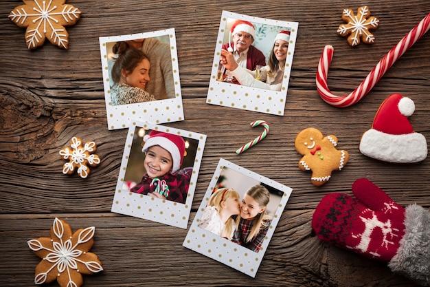 フラットは、木製の背景に幸せな家族の写真を置く 無料 Psd