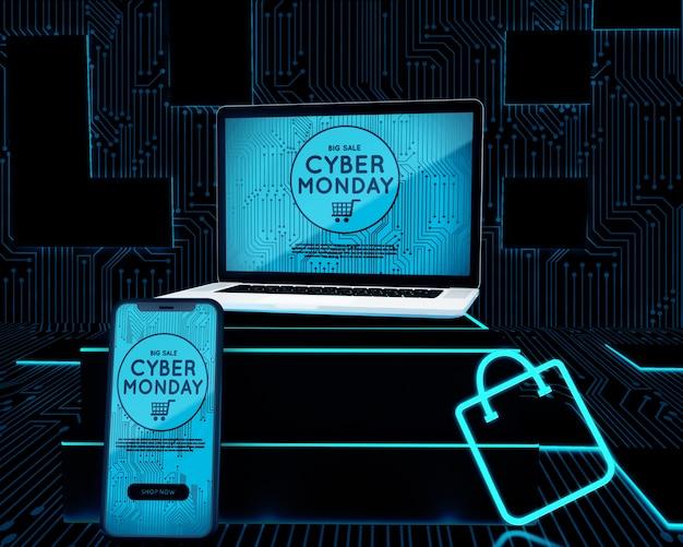 ネオンショッピングバッグの横にあるノートパソコンと携帯電話 無料 Psd