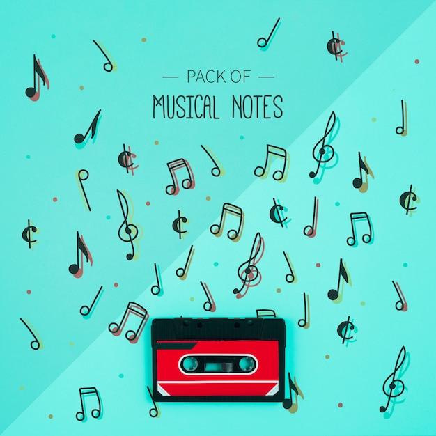 Набор музыкальных нот с лентой рядом Бесплатные Psd