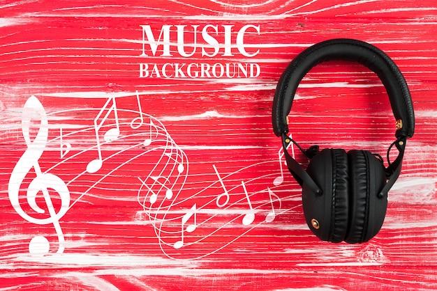 Музыкальные ноты и наушники на столе Бесплатные Psd