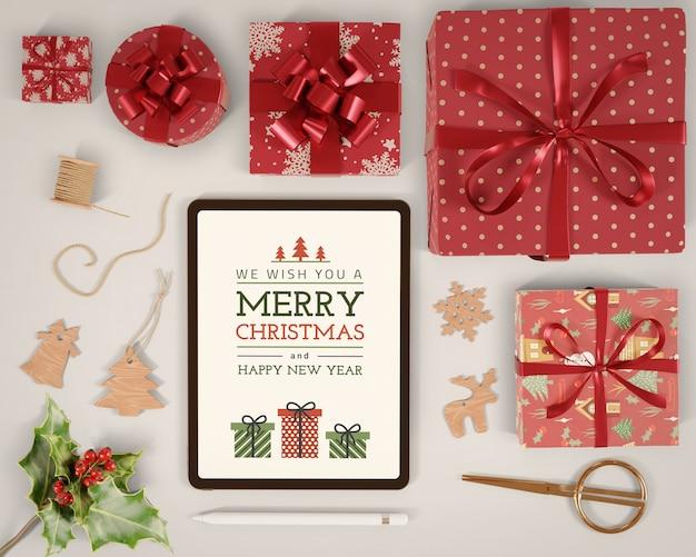 Планшет с рождественским сообщением на Бесплатные Psd