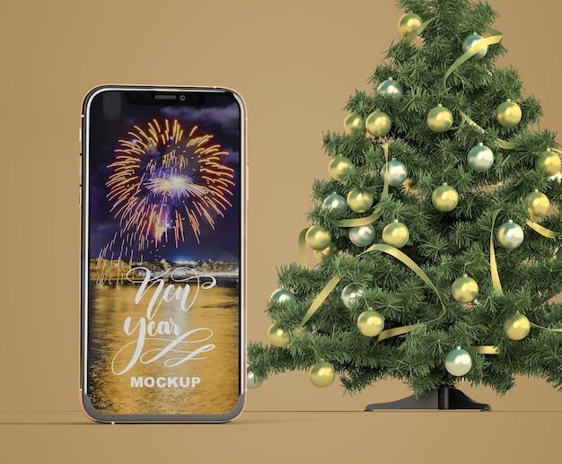 クリスマスツリーとスマートフォンのモックアップ 無料 Psd