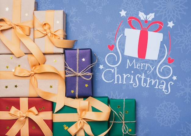 Вид сверху красочных рождественских подарков макет Бесплатные Psd