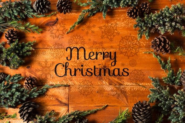 コロネットの枝とメリークリスマスメッセージのフレーム 無料 Psd