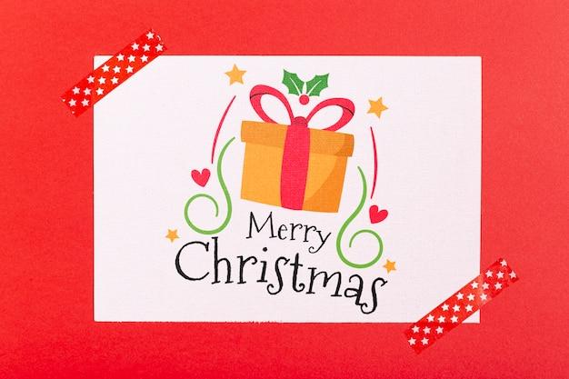 Счастливого рождества с подарочной коробкой и лентами Бесплатные Psd