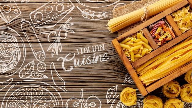 手描きの背景に木製の箱でトップビュー調理パスタの品揃え 無料 Psd