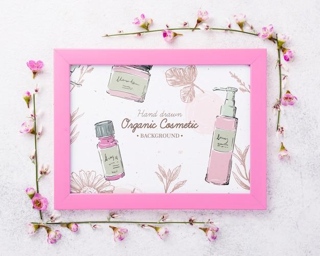 Вид сверху косметический макет с цветами Бесплатные Psd