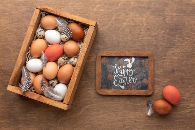 Яйца на пасху и рама с макетом Бесплатные Psd