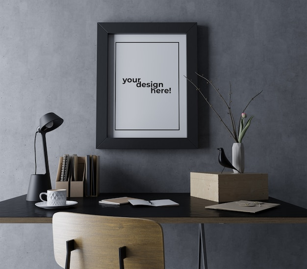 現実的なシングルポスターフレームモックアップデザインテンプレートモダンな黒のワークスペースでコンクリートの壁に肖像画をぶら下げ Premium Psd
