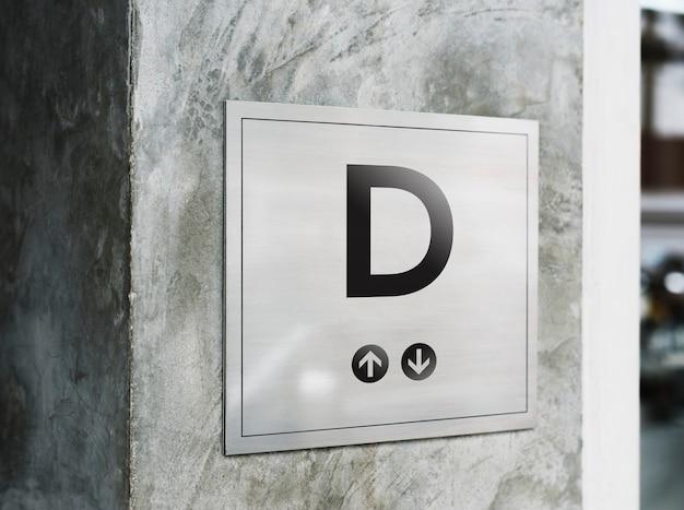 インダストリアルスタイルの壁に看板のモックアップ 無料 Psd