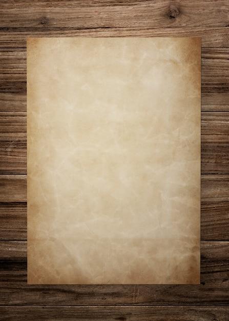 木製の背景にビンテージの紙のモックアップ 無料 Psd