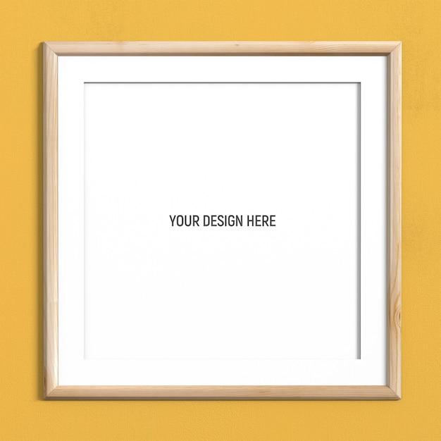 黄色の織り目加工の壁に正方形ライトウッドフレームモックアップ Premium Psd
