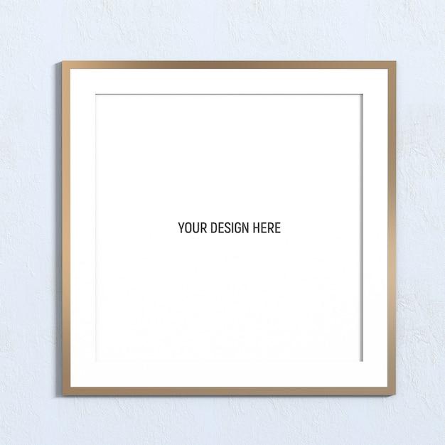 白い織り目加工の壁に正方形のゴールデンフレームモックアップ Premium Psd