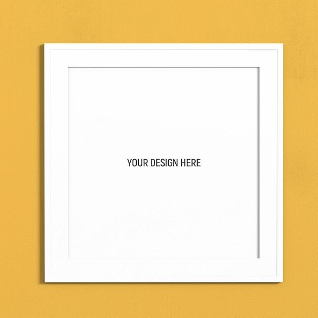 黄色のテクスチャ壁の正方形の白いフレームモックアップ Premium Psd