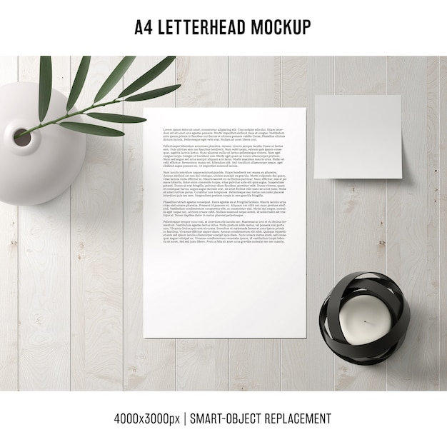 A4 letterhead mockup on wooden table Free Psd
