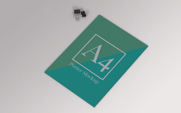 バインダークリップとペーパークリップ付きのa4ポスターモックアップ Premium Psd