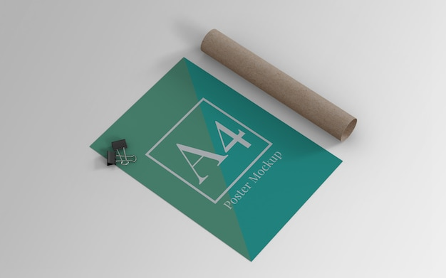 A4 poster mockup with binder clip and roll cardboard left view Premium Psd