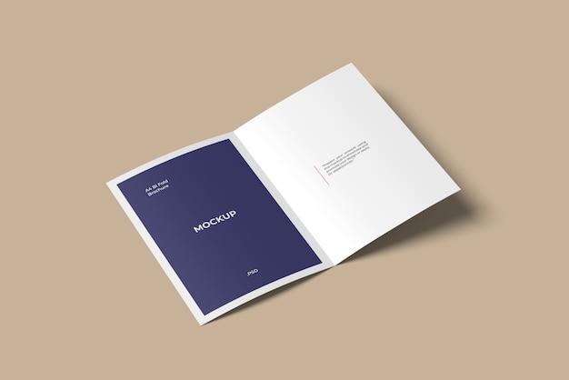 A4バイフォールドパンフレット/チラシモックアップハイアングル Premium Psd