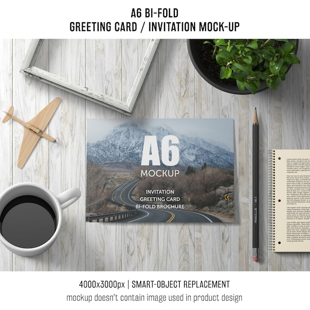 A6 bi-fold greeting card template with coffee and plant Free Psd