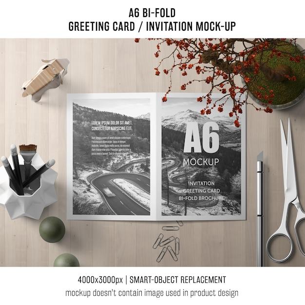 a6 bi fold invitation card template with scissors and plant psd file