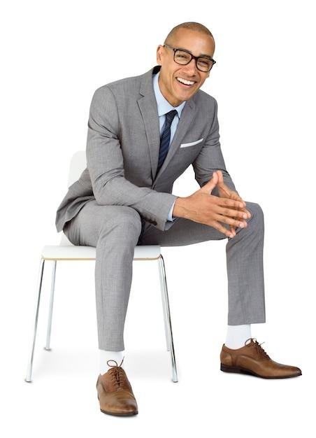 African descent business man sitting smiling Premium Psd