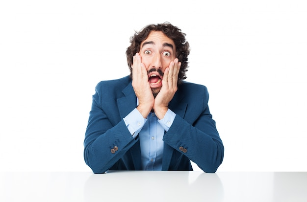 Amazed businessman with hands on face Free Psd