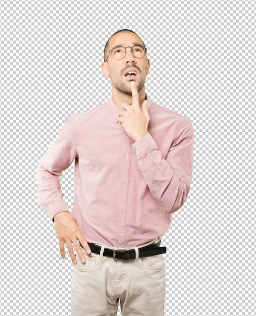 Amazed young man looking gesture Premium Psd