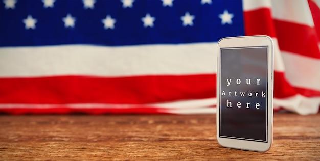 Американский флаг и мобильный телефон макет Premium Psd