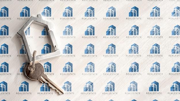 Apartment key on white real estate background Free Psd