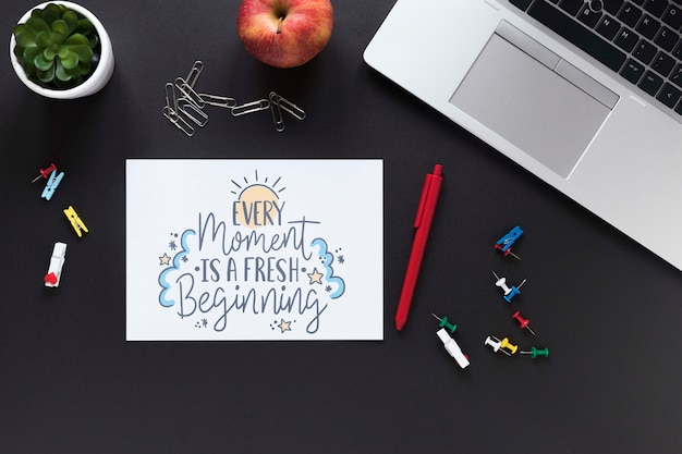 Apple laptop and business motivational message Free Psd