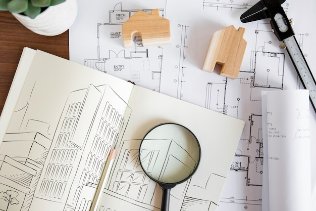 Architecture composition with paper mockup and magnifying glass Free Psd