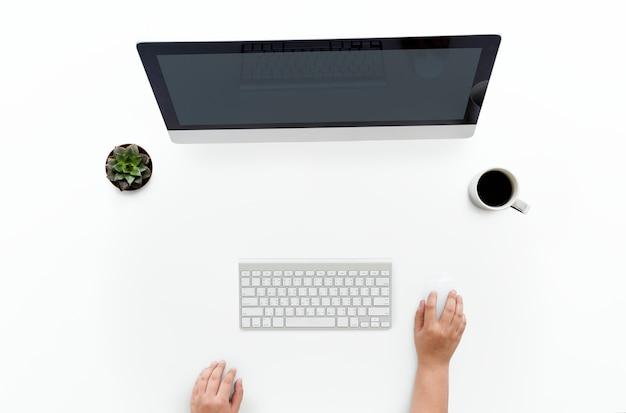 Ariel view of hands using a desktop computer Free Psd