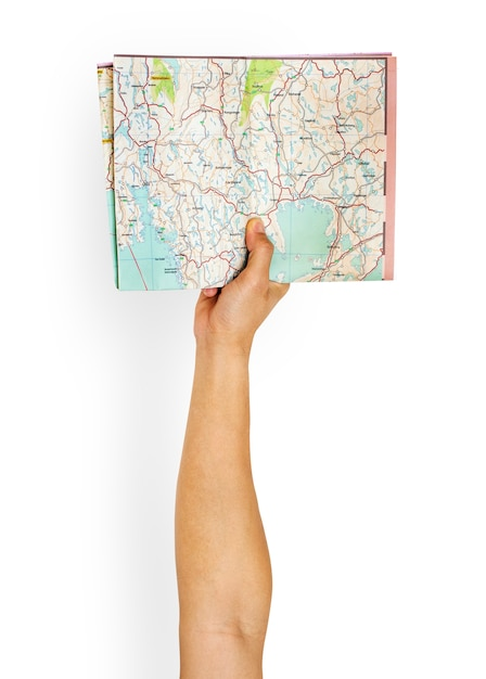 Arm raised with map in hand Free Psd