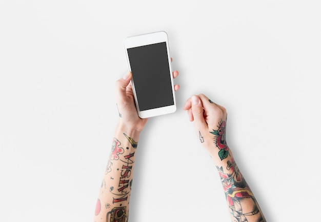 Arms with tattoos using smartphone Free Psd
