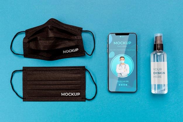Disposizione degli elementi del coronavirus con il mock-up dello smartphone Psd Gratuite