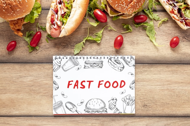 Arrangement of fast food mock-up on wooden table Free Psd
