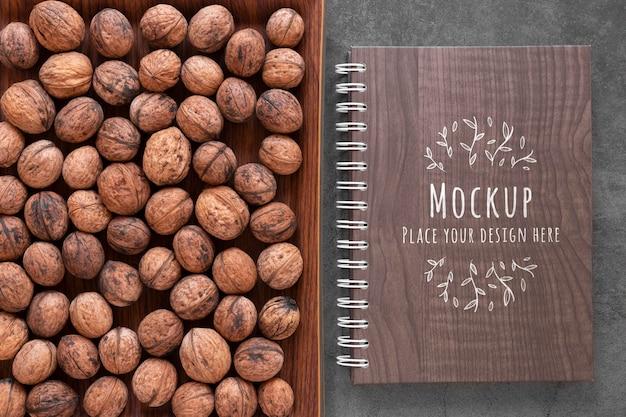 Arrangement of nuts with notebook mock-up Free Psd
