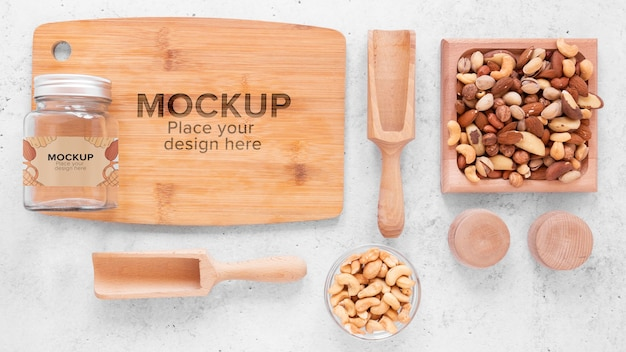 Arrangement of nuts with wooden board mock-up Free Psd