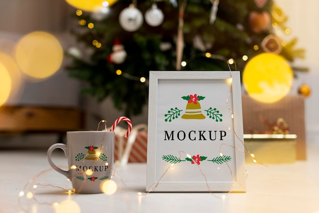 Arrangement with frame and cup mock-up Free Psd